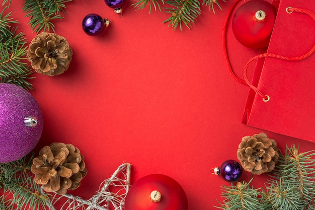 Frame of christmas decoration frame background on red  top view Premium Photo