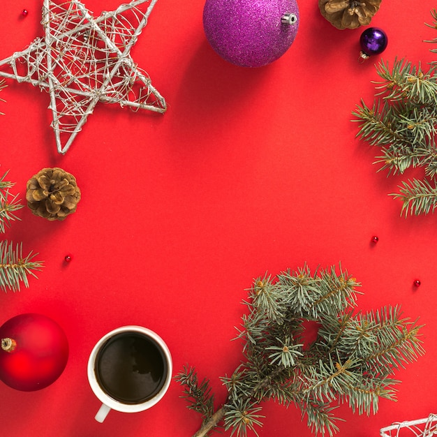 Frame of christmas decoration on red table top view Premium Photo