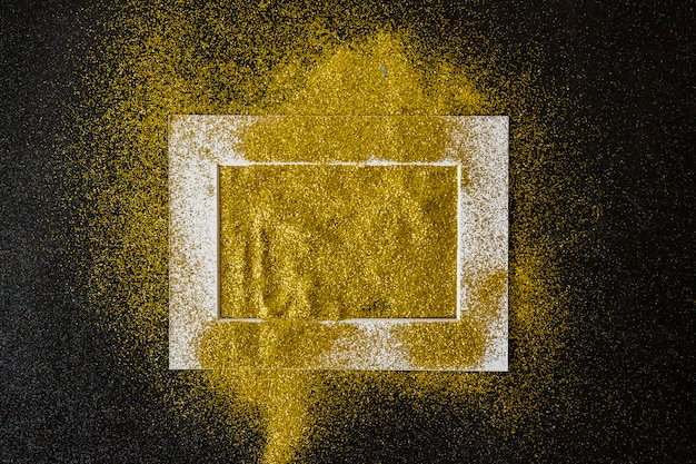 Frame covered with yellow sequins on table Free Photo