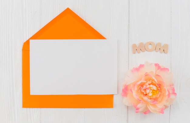 Frame envelope and peony with word mom Free Photo