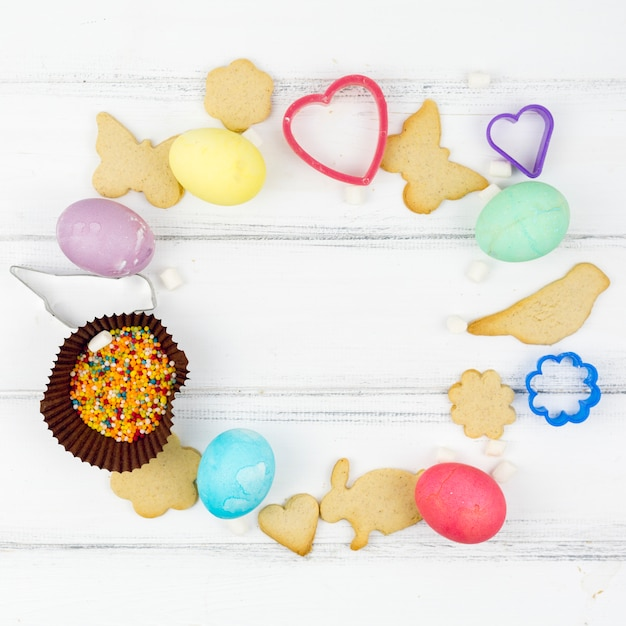 Frame from easter eggs with animal shaped cookies Free Photo