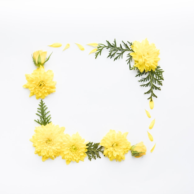 Frame from yellow flowers and leaves Free Photo