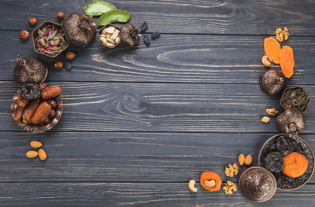 Frame made of different dried fruits with nuts Free Photo