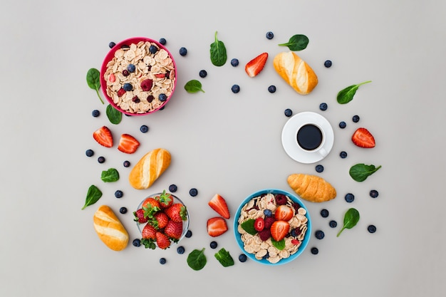 Frame made of fresh breakfast foods on grey background Free Photo