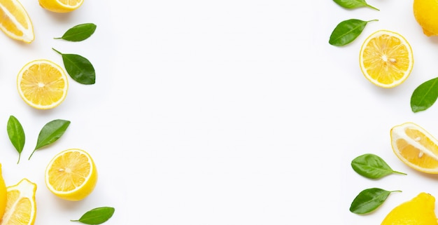 Frame made of fresh lemon and  slices  with leaves isolated on white Premium Photo