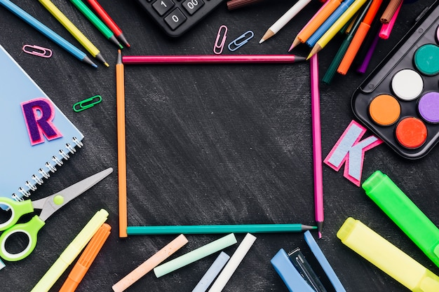 Frame made of stationery over chalkboard Free Photo