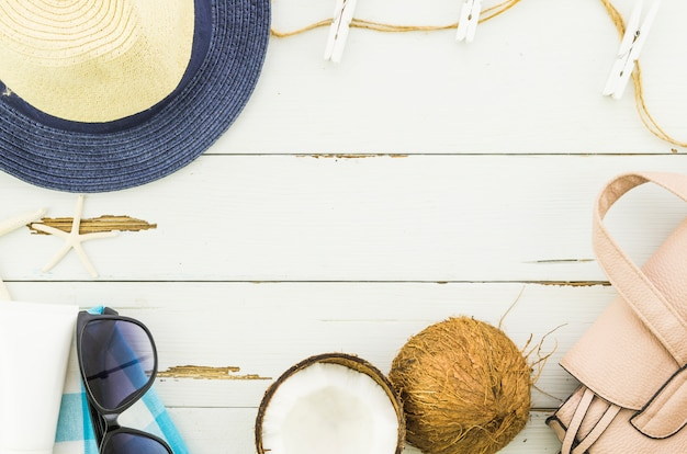 Frame of panama hat, sunglasses and coconut Free Photo