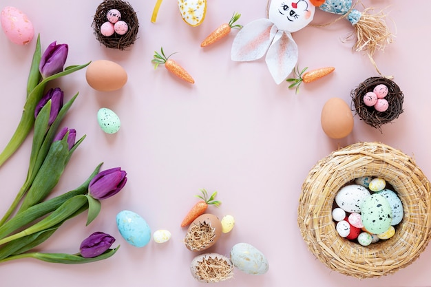Frame of rabbit, flowers and eggs Free Photo
