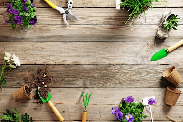 Frame of various flowers plant and garden tools Premium Photo