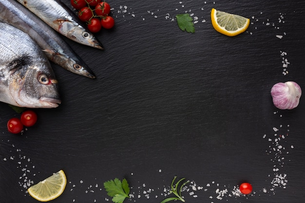 Frame with fish and condiments Free Photo