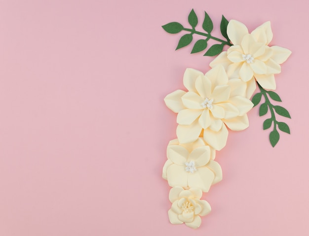 Frame with flowers on pink background Free Photo