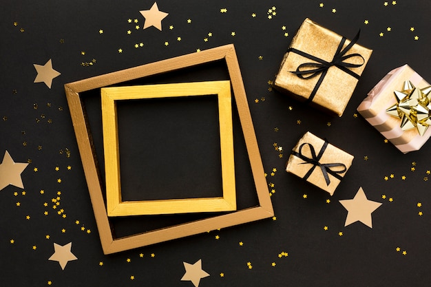 Frame with gifts beside Premium Photo