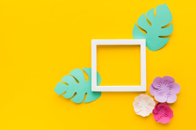 Frame with leaves and flowers paper ornamnet Free Photo
