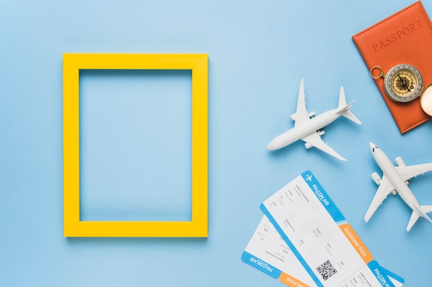 Frame with toy planes, tickets and passport Free Photo