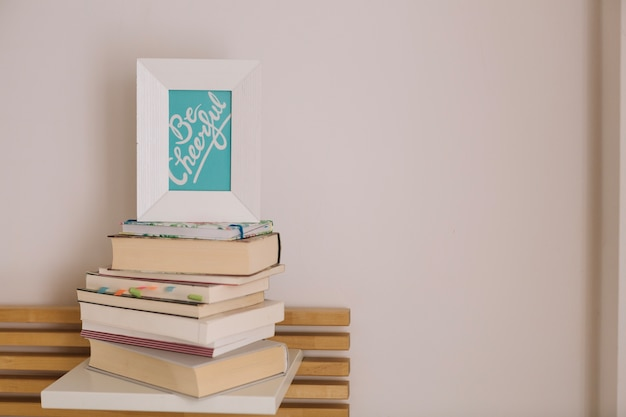 Frame with writing standing on books Free Photo