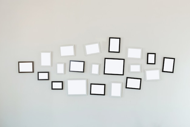 Frames hanging on white wall Premium Photo
