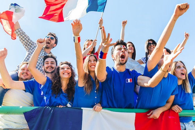 France supporters celebrating at stadium with flags Premium Photo