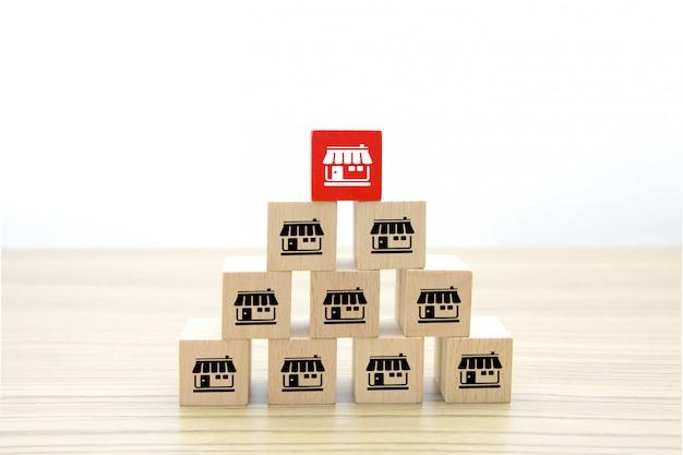 Franchise business icons on wooden cube shape. Premium Photo