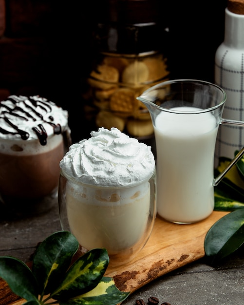 Frappuccino with coffee and milk on the table Free Photo