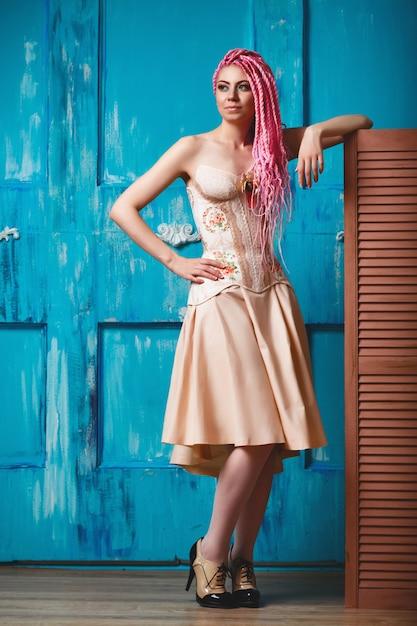Freaky young female model wearing corset Premium Photo