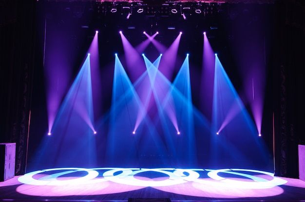 Free stage with lights, lighting devices. night show. Premium Photo