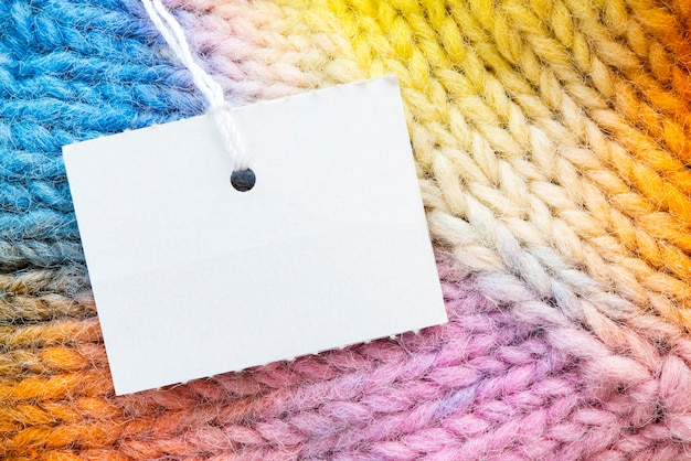 Free tag on rainbow gloves texture. Premium Photo