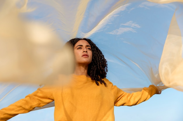 Freedom concept with woman holding cloth in nature Free Photo