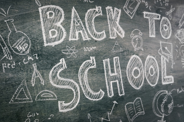 Freehand drawing back to school on chalkboard Free Photo