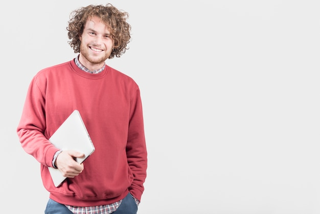 Freelance concept with man holding laptop Free Photo