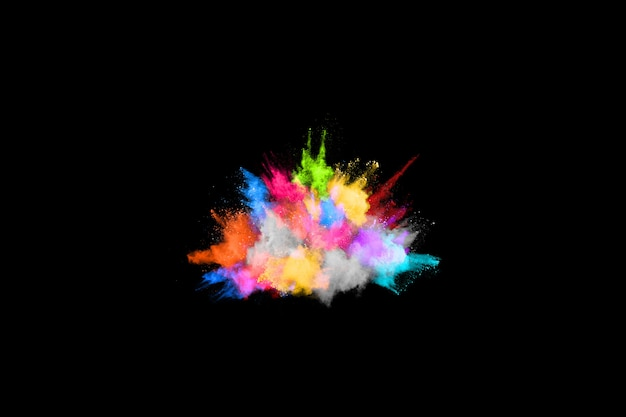 Freeze motion of color powder exploding/throwing color powder. Premium Photo