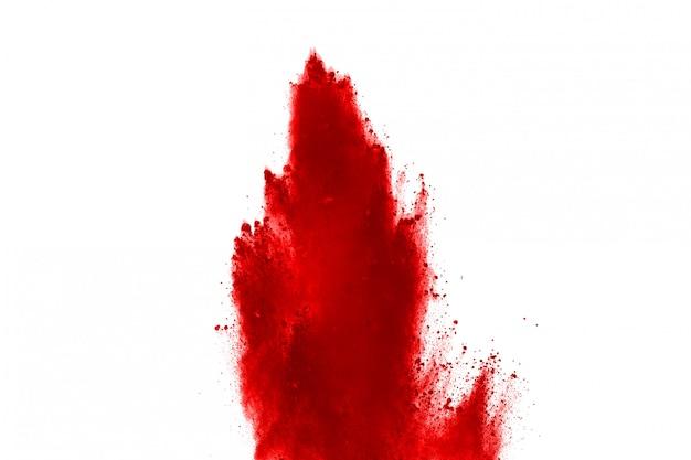Freeze motion of red powder exploding, isolated on white background Premium Photo