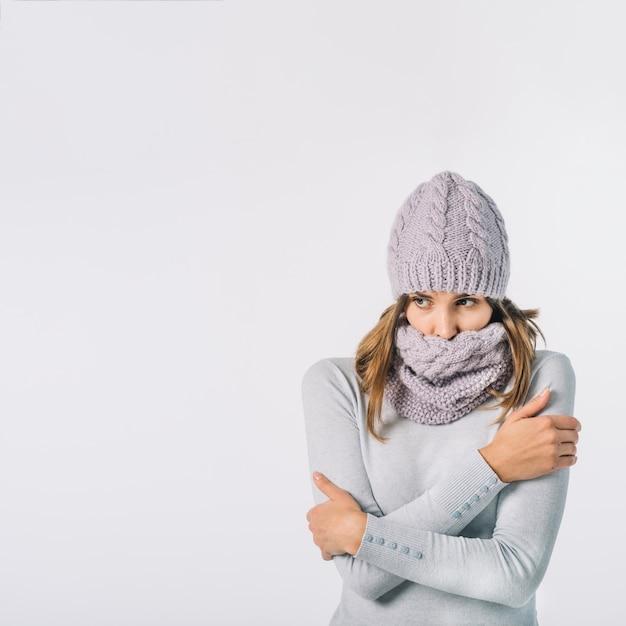 Freezing woman rubbing body Free Photo