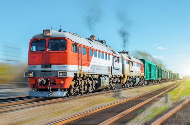 Freight train blur motion railroad embankment rail. Premium Photo