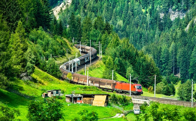 Freight train at the brenner railway in the austrian alps Premium Photo