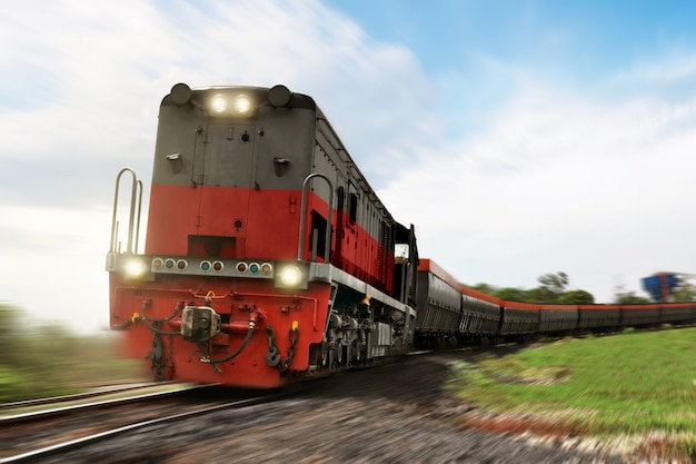 Freight train locomotive carrying with cargo Premium Photo