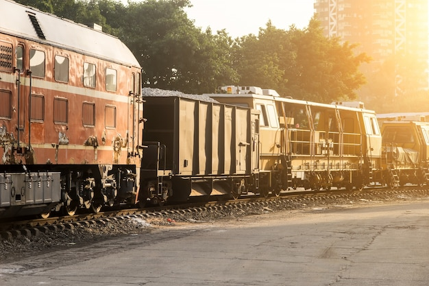 Freight train at sunset Free Photo