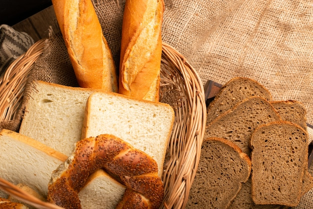 French baguette with turkish bagels and slices of bread in basket Free Photo