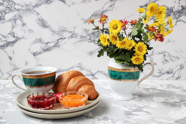 French breakfast with croissants, apricot jam, cherry jam