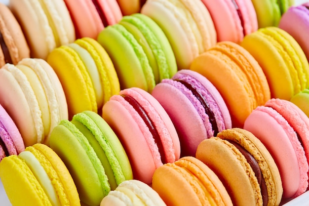 French colorful macarons background, close up. Premium Photo