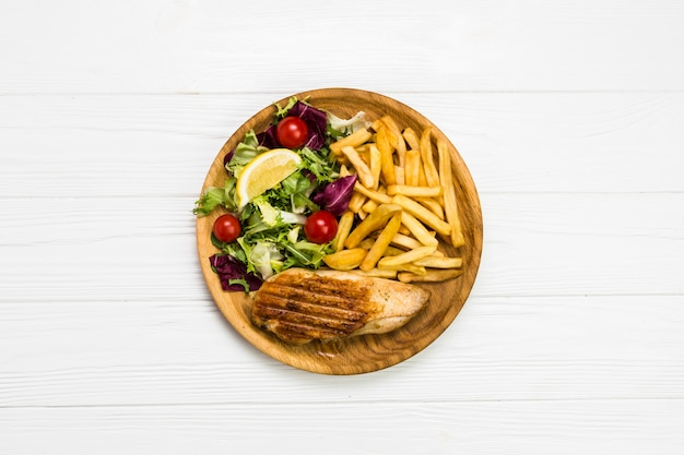 French fries and chicken with salad Free Photo