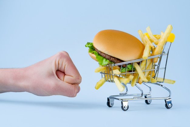 Premium Photo French Fries And Hamburger For Snack Fast Food Addiction Fighting Overweight And Obesity Refusal Of Junk Unhealthy Food