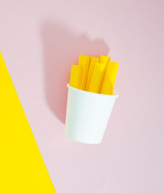 French fries replica on pink background Free Photo