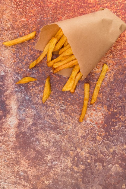 French fries spread on grey table Free Photo