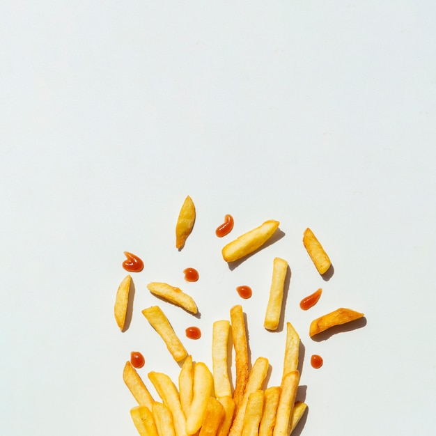 French fries with ketchup on gray background Free Photo