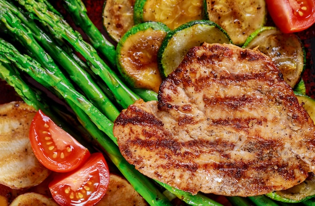 French fries with mushrooms and tomato, asparagus clouse up Premium Photo