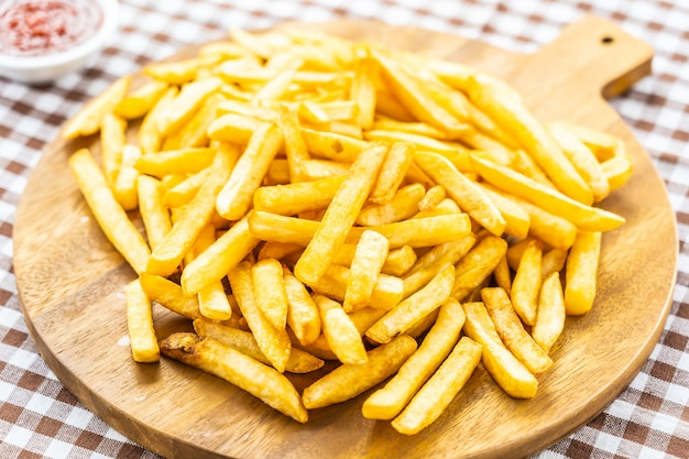 French fries with tomato or ketchup sauce Free Photo