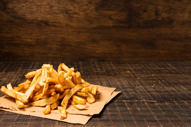 French fries on wooden table Free Photo