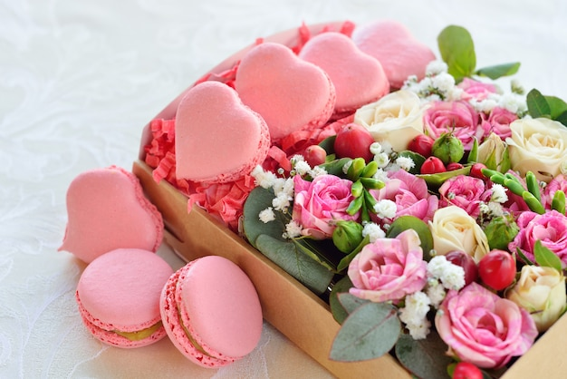 French macaron heart-shaped for valentine's day, with flowers Premium Photo