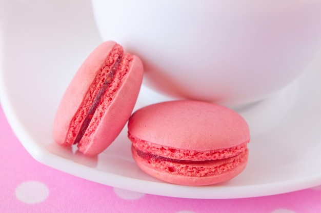 French macaroons with raspberry filling Premium Photo