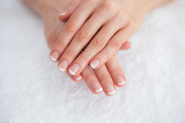 French manicured fingers at spa center Premium Photo